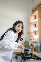 Asian women after wake up working in kitchen prepare breakfast meal