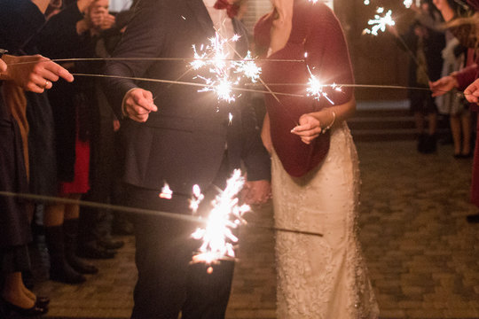 bride and groom on the background of sparklers at night