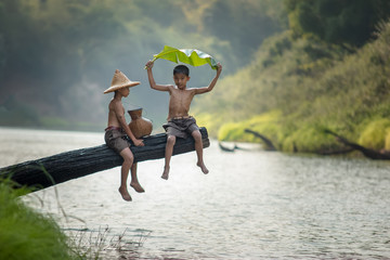 Children poverty living in countryside Vietnam are fishing at the river,Rural concept of Asia Wall mural