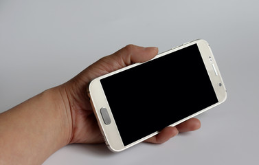 A hand holding a Smartphone.