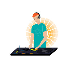 Young male DJ with red hair and hands on desk mixing music turntable needles on yellow light chaser background