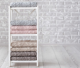 The stack of handmade plaids is lying on the shelves