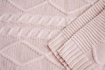 Knitted plaid with patterns clouse-up