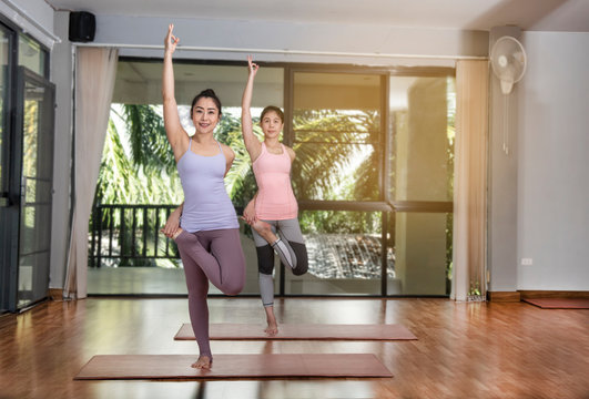 Sporty young woman doing yoga practice.  concept of healthy life and natural balance between body and mental development - Image