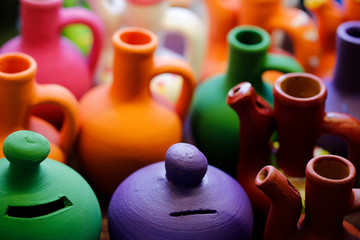 terracotta made ceramic, colored piggy bank and jugs
