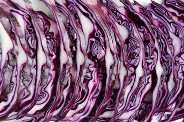 Shreded red cabbage close up.Straight row of chopped cabbage