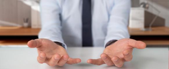 Businessman showing empty hands