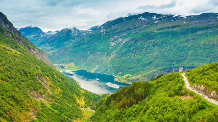 Fjord Geirangerfjord with ferry boat, Norway.