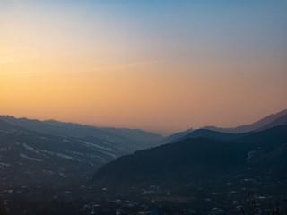 Amazing and beautiful view of the mountains in the rays of the setting sun