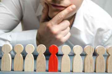 The boss dismisses the employee from the team. Personnel Management. Bad worker. Demotion. The concept of finding people and workers on the job. Selection of teams, the appointment of a leader. Hiring