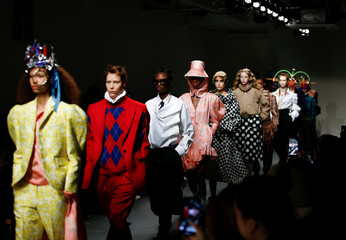Models present creations during the pushBUTTON catwalk show at London Fashion Week Women's A/W19 in London