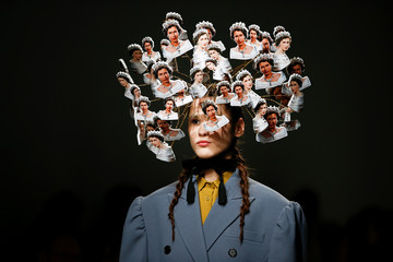 A model presents a creation adorned with images of Britain's Queen Elizabeth during the pushBUTTON catwalk show at London Fashion Week Women's A/W19 in London