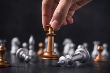 man makes the final move in the game of chess