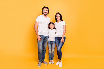 Full length body size view portrait of nice sweet lovely attractive cheerful cheery people mom dad hugging pre-teen girl isolated over shine vivid pastel yellow background