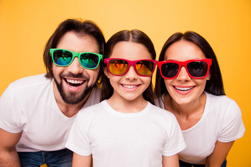 Close-up portrait of nice cute lovely attractive cheerful people having fun day dream wearing colorful modern eyeglasses eyewear trend isolated on shine vivid pastel yellow background
