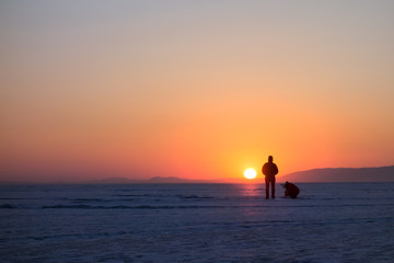 People figures at sunset in winter