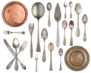 Set of 20 gorgeous old vintage items. Old silverware, spoons, forks, metal plates Isolated on white background.