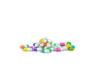 Different pharmaceutical medicine pills, tablets and capsules in different colors on white background. Health care concept. 3D render illustration.