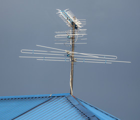 TV antenna on the roof of the house