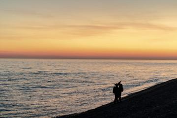 sunset lover beach silhouettes
