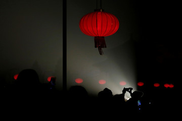 Visitor takes a picture under a red lantern during an event to celebrate the Chinese Lantern Festival at the Forbidden City on the last day of the lunar new year celebrations in Beijing
