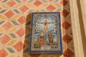 Tiles in a catholic church with artwork of the passion of Jesus Christ