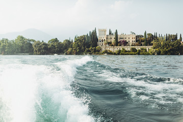 Look from a boat at beautiful estate on the shore. Italy