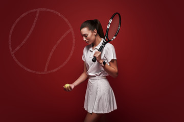 Tennis Anyone Young tennis player standing isolated over red background with a racket and a ball