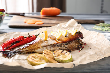 Tasty mackerel fish with vegetables on parchment