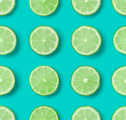 Fruit pattern of lime slices on blue background. Flat lay, top view. .  Pop art design, creative summer concept.. Creative layout.