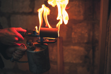 Old rusty blowtorch with flame