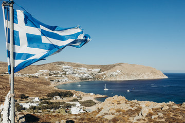 Flag of Greece hangs over the beautiful seaside landscape