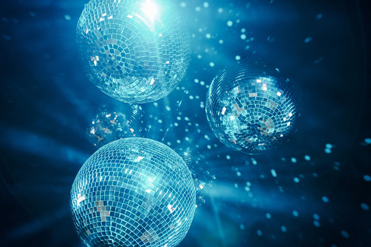 classic blue shining disco balls. disco atmosphere concept. color of the year 2020