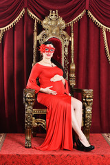 Portrait of beautiful young pregnant woman in mask posing