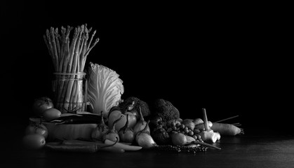 Fresh vegetables on dark floor and black color background