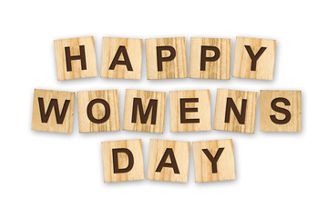 Happy woman's day, the inscription composed of the alphabet on wooden cubes. White background. Isolated. Holiday
