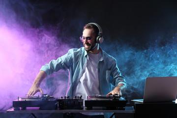 Male DJ playing music in club
