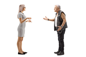 Young woman talking to an angry male punker in a leather vest