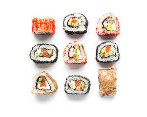Fotobehang Sushi bar Tasty sushi rolls on white background
