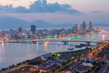 Aluminium Prints Los Angeles Da Nang, Vietnam – Business and Administrative District of Da Nang city on the Han River during night with night views. Picture taken on Apr 2018