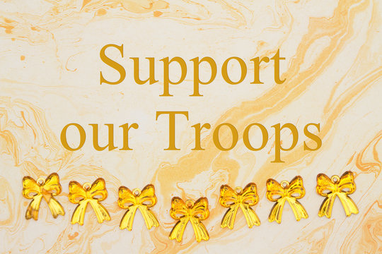 Support our Troops message with yellow ribbons on textured watercolor paper