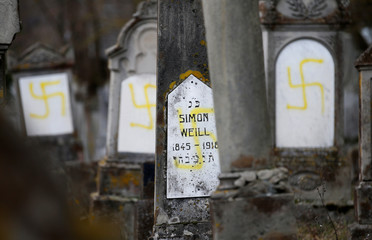 Graves that were desecrated with swastikas are seen at the Jewish cemetery in Quatzenheim