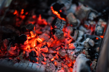 Burning red coals in the fire