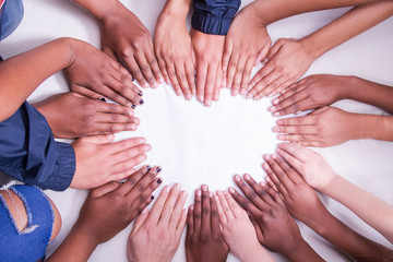 multi national skin colour hands in a heart shape