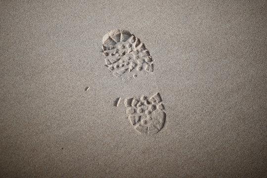 A shoe print is seen on the beach in Sangatte, near Calais