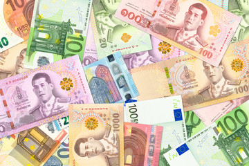 some thai baht and euro banknotes indicating trade relations