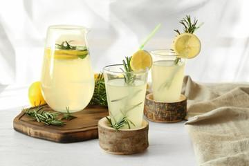 Glassware of fresh lemonade on table