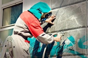 Foto auf AluDibond Graffiti Graffiti remover