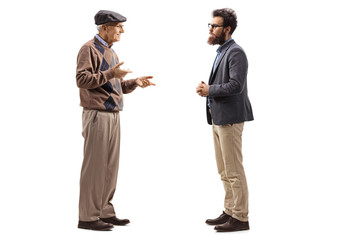 Elderly man talking to a younger bearded man