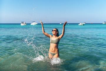 Pretty pan asian travel girl have fun in blue sea water.